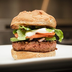 Organic burger made with Beyond Burger Veggie pattie on a gluten free bun in the kitchen