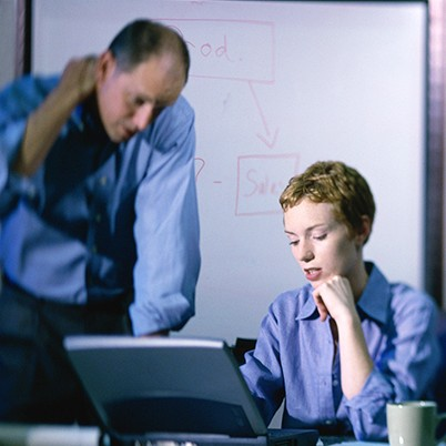 Businessman and a businesswoman working on a laptop