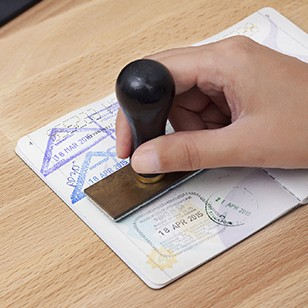 Immigration control officer will arrival stamp in the passport