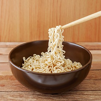 Noodle in brown bowl with wooden chopsticks