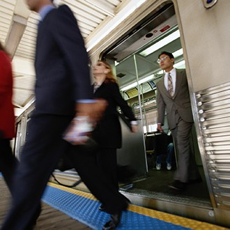 Businesspeople Exiting Train